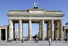 Brandenburg Gate in Berlin. Tourists in front of the Brandenburg Gate in Berlin royalty free stock photos