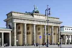 Brandenburg Gate in Berlin. Tourists in front of the Brandenburg Gate in Berlin stock photo