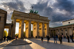 Brandenburg Gate in Berlin. Tourists visit the Brandenburg Gate at sunset on April 16, 2017 in Berlin, Germany. The Gate, a 18th century neoclassical monument royalty free stock photos
