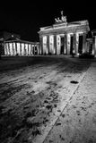 Brandenburg Gate, Berlin. Wide view of the historic Brandenburg Gate in Berlin, Germany, on a cold and quiet winters evening.  Black and white with visible film Stock Photography