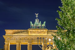 Brandenburg gate and christmas tree. In Berlin, Germany Royalty Free Stock Photos