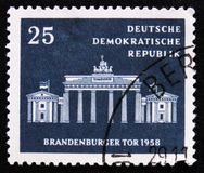 Brandenburg gate, circa 1958. MOSCOW, RUSSIA - APRIL 2, 2017: A post stamp printed in DDR shows Brandenburg gate, circa 1958 Stock Image