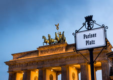 Brandenburg Gate in a cloudy sunset. In spring time Stock Images