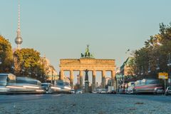 Brandenburg gate from the ground perspective with tv tower in background royalty free stock images