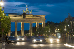 Brandenburg Gate lit with cars night. Night scene Brandenburg Gate lit with car pedestrian traffic at night on Unter den Linden Berlin Germany Europe Royalty Free Stock Photo
