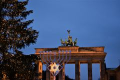 Brandenburg gate and Menorah stock photos
