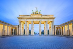 The Brandenburg Gate monument at night in Berlin city, Germany royalty free stock image