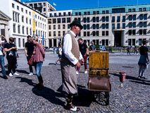 Traditional Organ Grinder at the Brandenburg Gate is Berlin`s most famous landmark. Royalty Free Stock Image