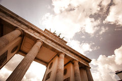 Brandenburg Gate and the Quadriga. The Brandenberg Gate in Berlin towards the statue of the Quadriga on the top against a cloudy sky Royalty Free Stock Images