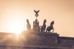 Brandenburg gate quadriga sight in berlin city germany europe. Sunset behind the german symbol and landmark Brandenburger Tor at Pariser Platz in the german Royalty Free Stock Images