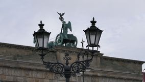 Brandenburg Gate in the rear view with a street lamp Royalty Free Stock Photos