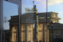 Brandenburg gate. The reflection in the glass, the Brandenburg gate, city gate of Berlin, the blue sky, the lanterns, the chariot Stock Photo