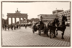 Brandenburg Gate, Berlin, Retro style. Old Postcard style: Coachman wit horse-drawn carriage in front of the Brandenburger Tor - Brandenburg Gate stock photo