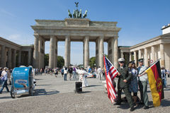 Brandenburg Gate with disguised soldiers and fla stock photos