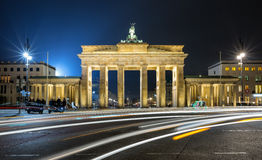 Brandenburger Tor in Berlin by night with blurred traffic lights royalty free stock images