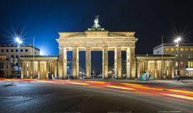 Brandenburger Tor in Berlin, by night with red traffic lights stock photography