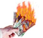 Brandend geld Stock Foto