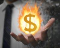 Brandende brandbal van dollarteken in de hand van de zakenman Stock Fotografie