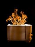 Brandende broodrooster stock afbeeldingen