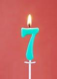 Brandende kaars als nummer zeven Stock Afbeeldingen