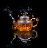 Brandende thee Stock Afbeeldingen
