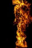 Brandflamma på svart bakgrund royaltyfria bilder