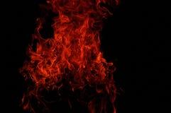 Brandflammor på black arkivbild