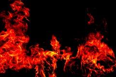 Brandflammor p? svart bakgrund f?r abstrakt konst, br?nnande gl?dheta gnistor stiger arkivfoton