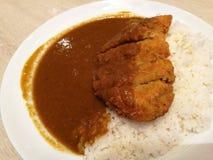 Brandhöna med curryris Arkivbilder