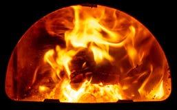 Brandhout in de oven van het bad stock foto