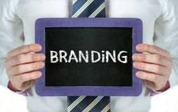 Branding. Man holding blackboard with word Branding Royalty Free Stock Images
