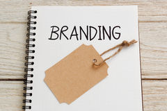 Branding with brand tag. Branding concept with brand tag on notebook royalty free stock photo