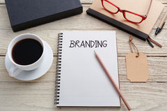 Branding concept with brand tag. Branding concept with notebook brand tag and product box on work desk royalty free stock image