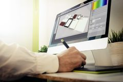 Branding designer working. All screen graphics are made up Stock Photos
