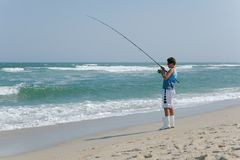 Branding die van Sandy Hook-strand vissen stock fotografie