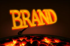 Branding Iron. Red hot branding iron with the word BRAND in glowing letters over a brazier of red hot coals vector illustration