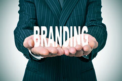 Branding. Man wearing a suit with the word branding in his hands Royalty Free Stock Image