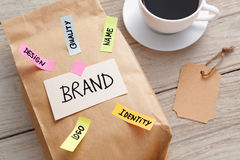 Branding marketing concept with paper bag and brand tag. Branding marketing concept with kraft paper bag, brand tag and coffee cup Royalty Free Stock Photography