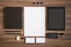 Branding mockup set on brown wooden desk with