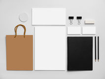 Branding mockup with shopping bag. Stationery on. Branding mockup with shopping bag. Set of stationery on gray background. Black notepad, blank business cards Royalty Free Stock Photography