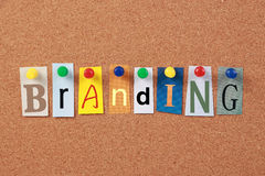 Branding Single Word. The word Branding in cut out magazine letters pinned to a corkboard Stock Photos