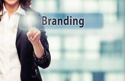 Branding. Smiling business woman pressing Branding button at her office stock photography