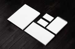 Branding stationery, mockup scene on black wooden plank, blank objects for placing your design.  stock photo
