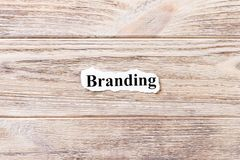 Branding of the word on paper. concept. Words of Branding on a wooden background.  royalty free stock photos