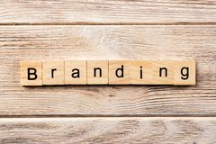 Branding word written on wood block. branding text on table, concept stock photography
