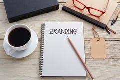 Brandingkonzept mit Markentag Lizenzfreies Stockbild