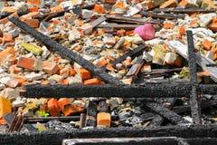 Brandkatastrof för trä för detalj för brandhemrest royaltyfri bild