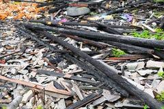 Brandkatastrof för trä för detalj för brandhemrest arkivbilder