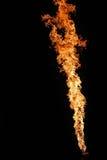 Brandkunstenaar die brand ademhaling uitvoeren stock foto's