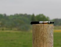 Brandless E-Cigarette2. An electronic cigarette resting on a fence post Stock Photos